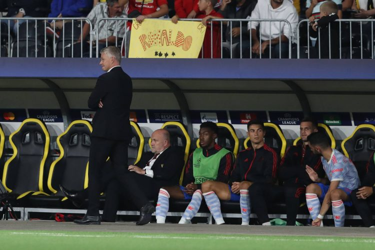 Berne, Switzerland, 14th September 2021. Cristiano Ronaldo of Manchester United, ManU reacts on the bench as Ole Gunnar Solskjaer manager of Manchester United walks Ole Gunar Solšer Kristijano Ronaldo